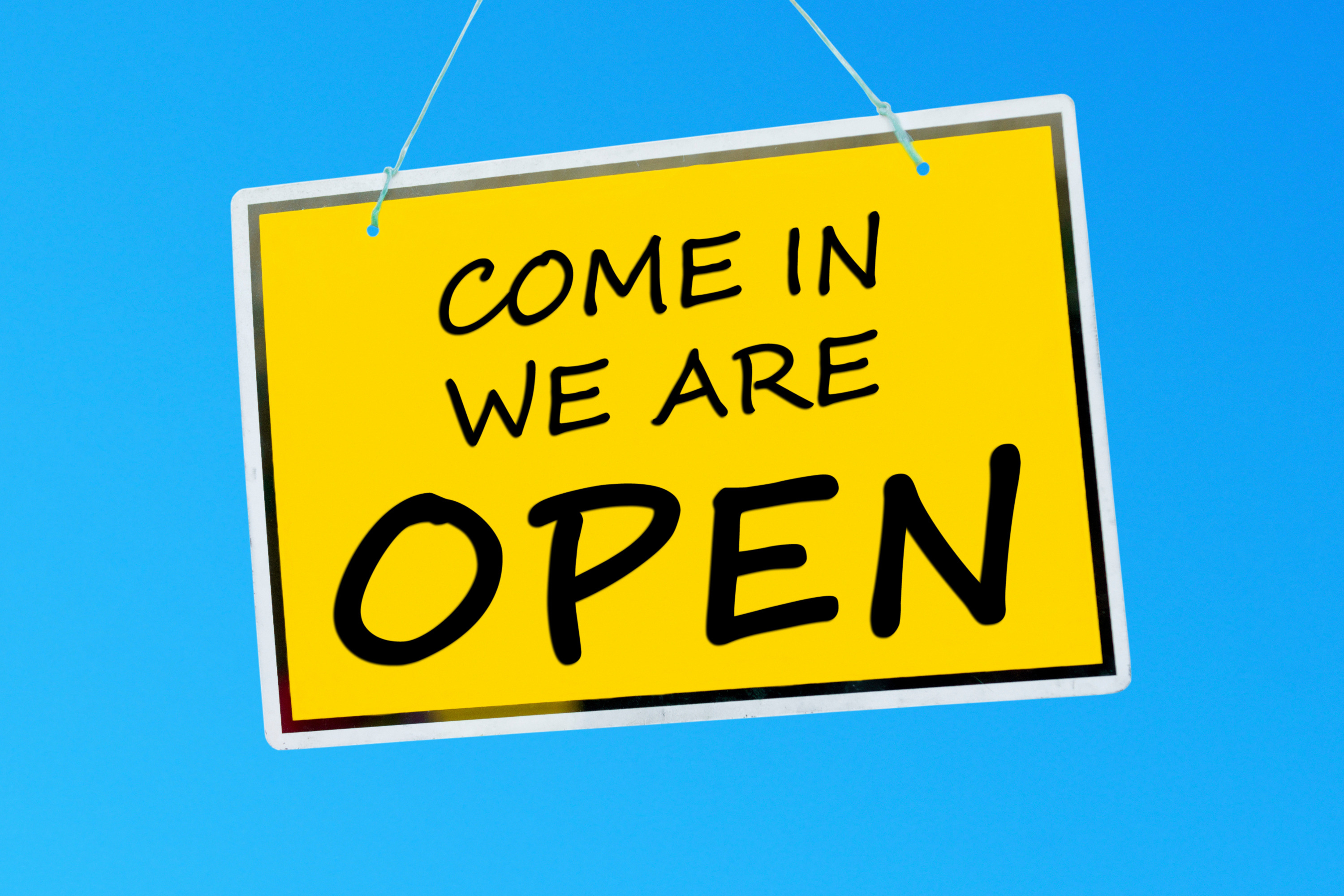 Sign depicting come in, we are open for business 24 hours per day, 7 days per week, 365 days per year
